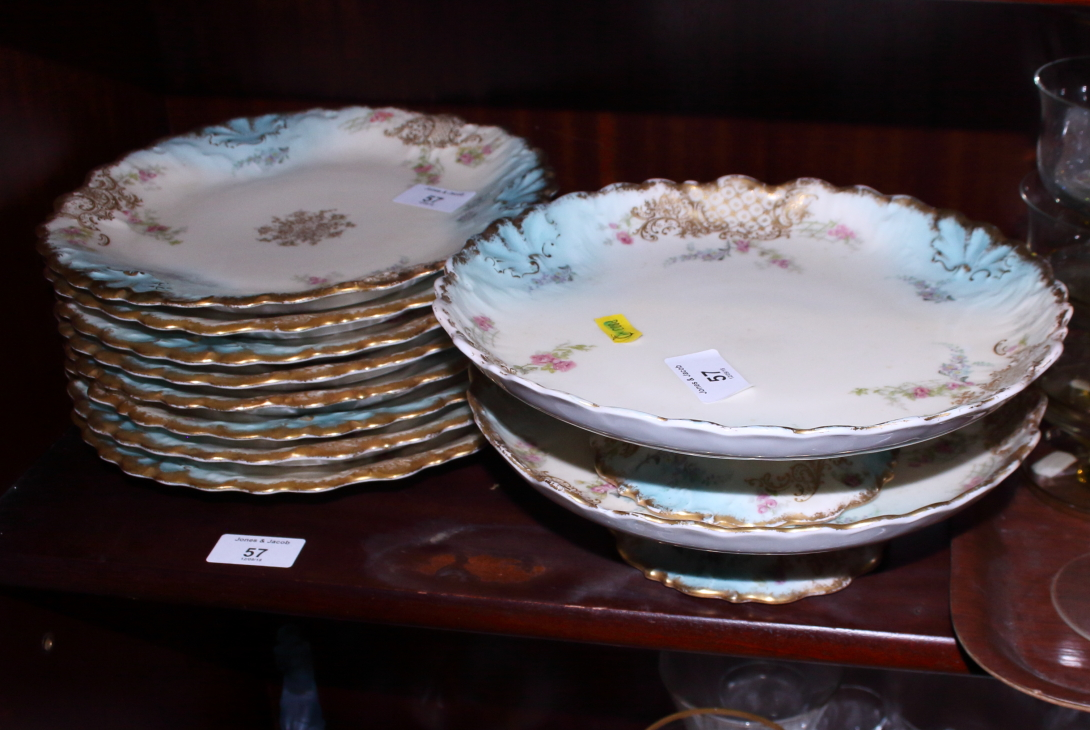 Lot 57 - A Limoges porcelain part dessert service with floral and gilt highlighted borders