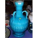 "A Burmantofts faience three-handled pottery vase, 22"" high"