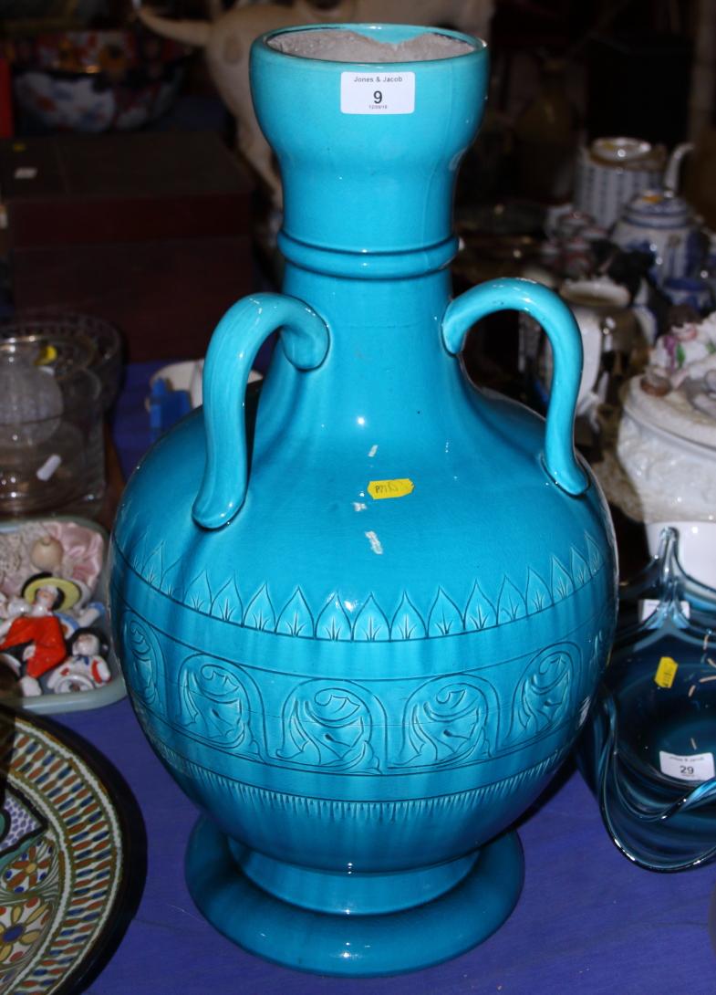 "Lot 9 - A Burmantofts faience three-handled pottery vase, 22"" high"