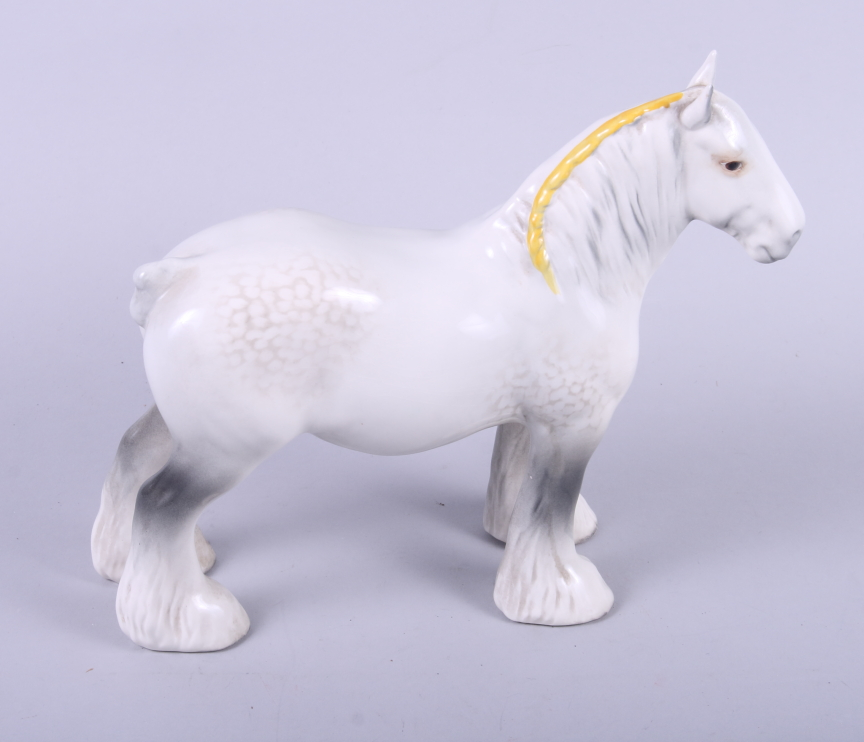 Lot 6 - A Beswick shire horse, two other horse models, a terrier and a greenfinch