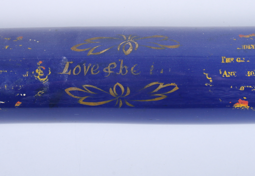 Lot 34 - A 19th century Bristol blue glass rolling pin, decorated with gilt painted script and sailing boats,