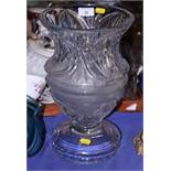 "A heavy cut glass pedestal vase with flared rim, 13 1/2"" high"