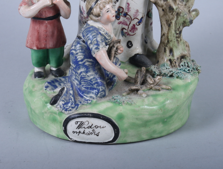 """Lot 23 - An 18th century Staffordshire figure, """"Widow and Orphans"""", 11"""" high (restorations)"""