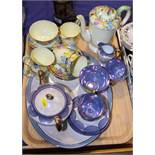 An early 20th century Crown Staffordshire porcelain teaset, decorated with a band of pansies,