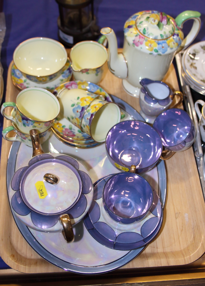 Lot 58 - An early 20th century Crown Staffordshire porcelain teaset, decorated with a band of pansies,
