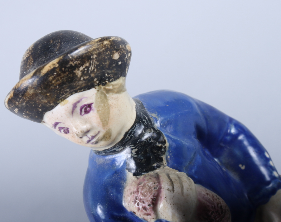 "Lot 18 - An early 19th century Staffordshire figure of a sailor, 7 1/2"" high"