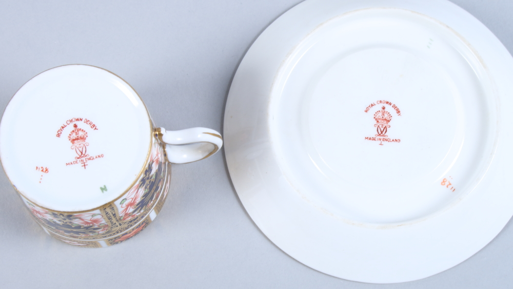 Lot 1 - A Royal Crown Derby, pattern 1128, coffee can and saucer