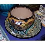 """A mid 20th century Gouda pottery charger, richly painted with flowers and abstract pattern, 17"""" dia,"""
