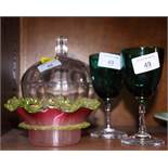 A pair of Victorian green glass wines, a lamp work shallow bowl and a toilet jar and cover