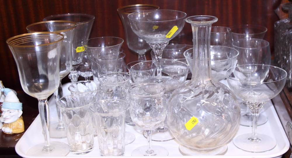 Lot 42 - An oak and brass mounted three-bottle tantalus and a number of drinking glasses, various