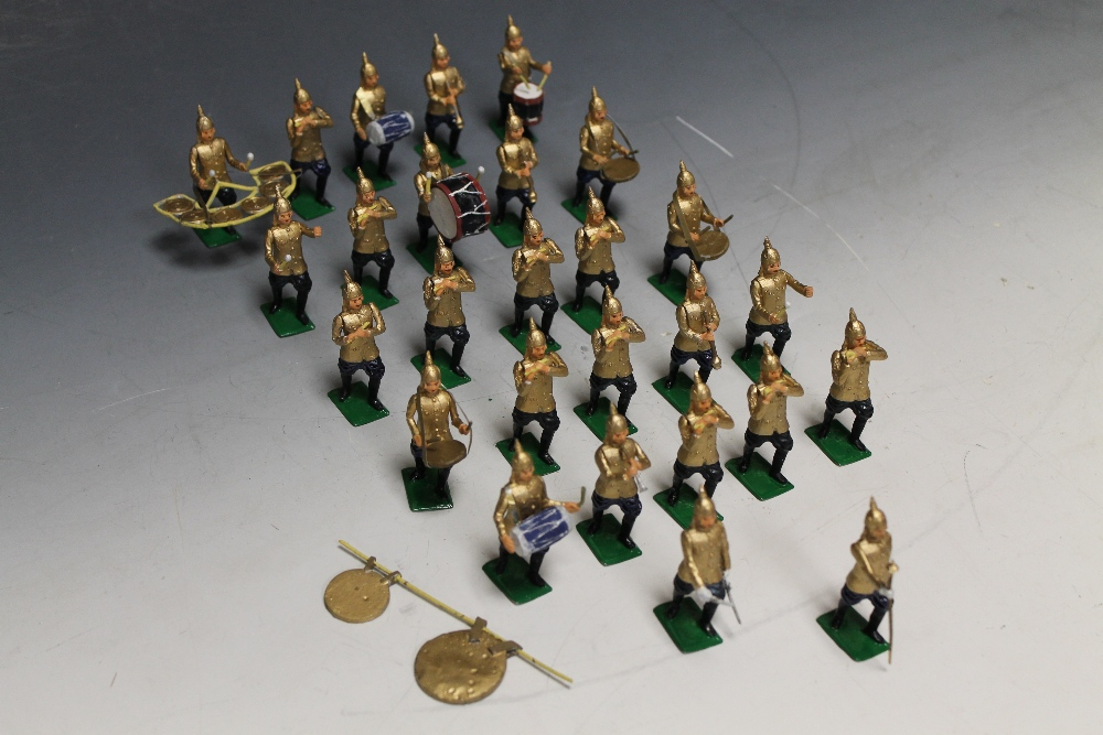 Lot 145 - A COLLECTION OF REPRODUCTION METAL SOLDIERS OF MARCHING BANDS including Women's Royal Canadian Naval