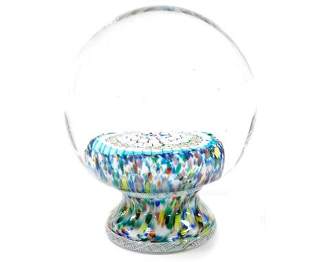 An early 20thC Millefiori paperweight glass dump, with various layered cane decoration, one bearing the numbers 7848, on a mu