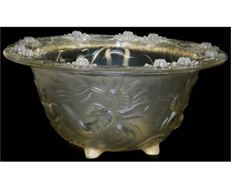 A large art glass bowl, in the Lalique style, depicting mermaids and water lilies, on a four foot stemmed base, 14cm high, 31
