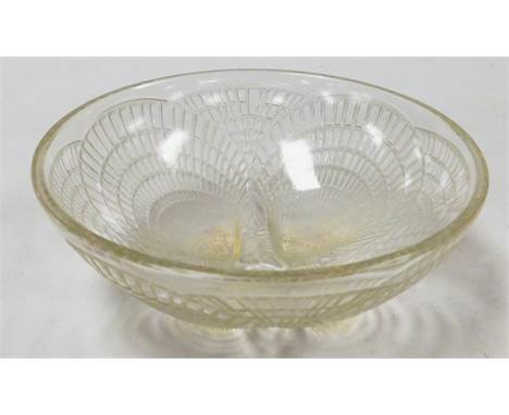 A Lalique Coquilles pattern glass bowl, shaped with four shells on feet in outer decoration, signed R Lalique France NI3204,