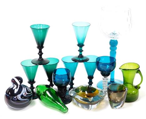 A group of coloured glassware, to include a set of seven late 19thC green glass wine glasses, a green glass jug, a coloured d