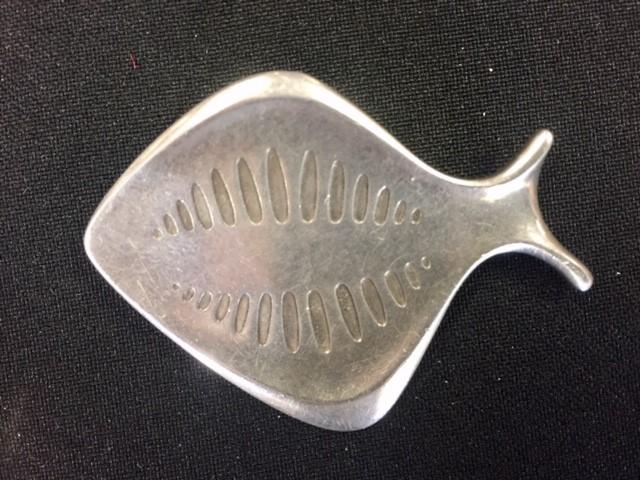 Lot 14 - Henning Koppel for Georg Jensen - a Danish silver modernist brooch, an abstract fish, no. 343,