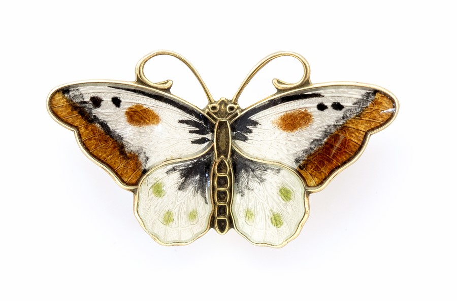 Lot 40A - Hroar Prydz - a Norwegian silver and enamel butterfly brooch, in tones of white brown and green,