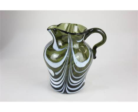 A late 18th / early 19th century Nailsea glass jug, in green with swirled white enamel stripes, 14cm high, to the present own