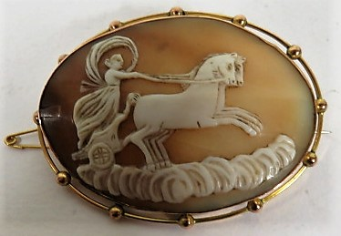 Lot 37 - A large 9ct gold oval cameo brooch of Diana the Huntress, measuring approximately 55.3mm x 44mm,
