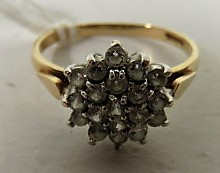 Lot 43 - A marked 375 and import marks gold white stone cluster ring, ring size O 1/2, weight 2g