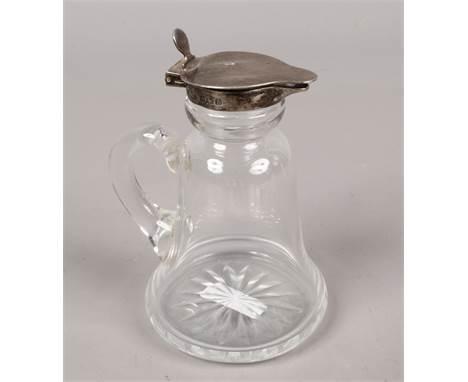 A silver top glass Whisky noggin, assayed Birmingham 1917 by Asprey & Co. Ltd.