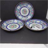 A set of three 19th century Chinese porcelain plates with floral decoration, D.23cm