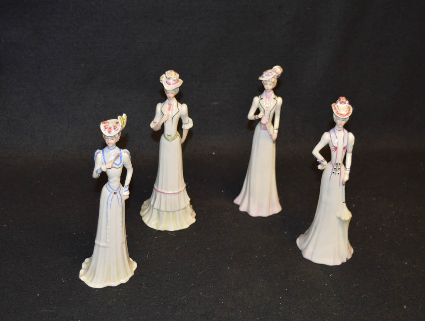 Lot 39 - An Epoca Set of Four Figurines