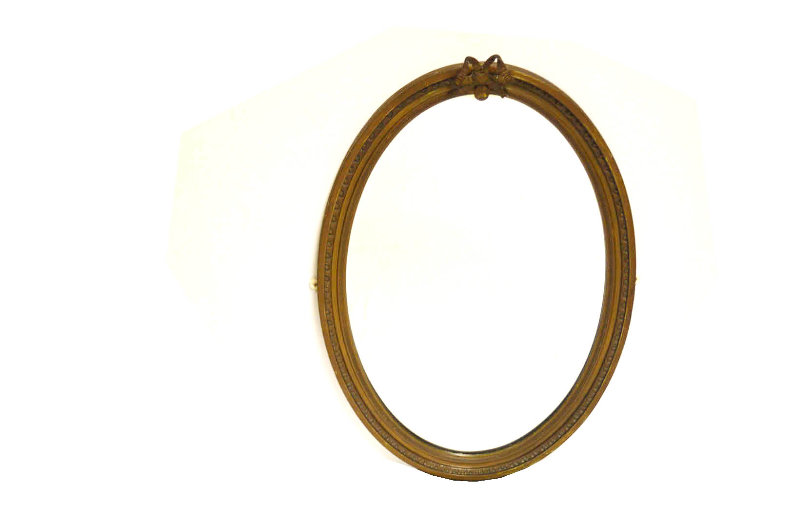 Lot 51 - An Oval Gilt Framed Bevelled Glass Wall Mirror, Ribbon Top
