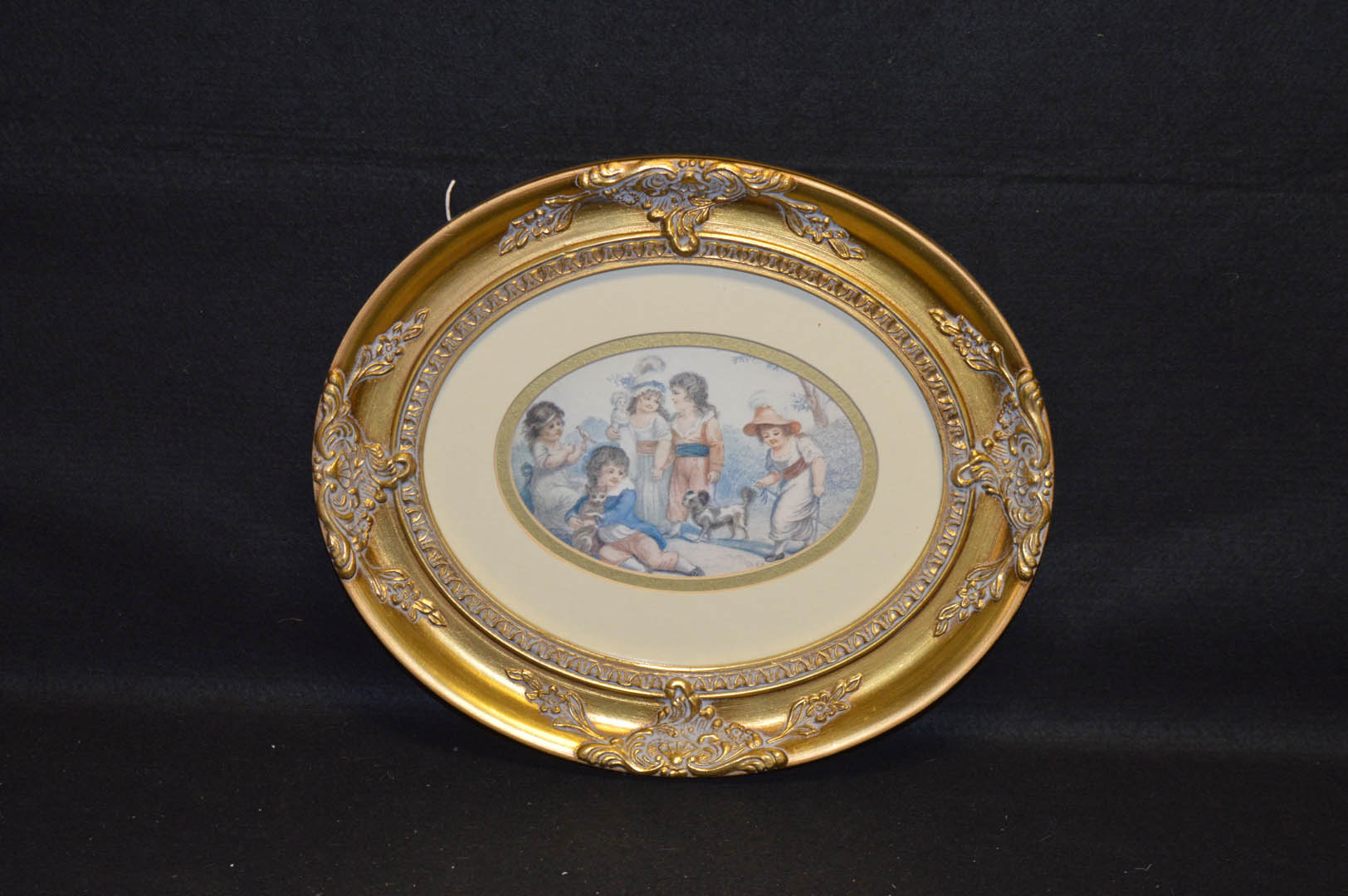 Lot 132 - A Gilt Framed Oval Picture 'Children Playing'