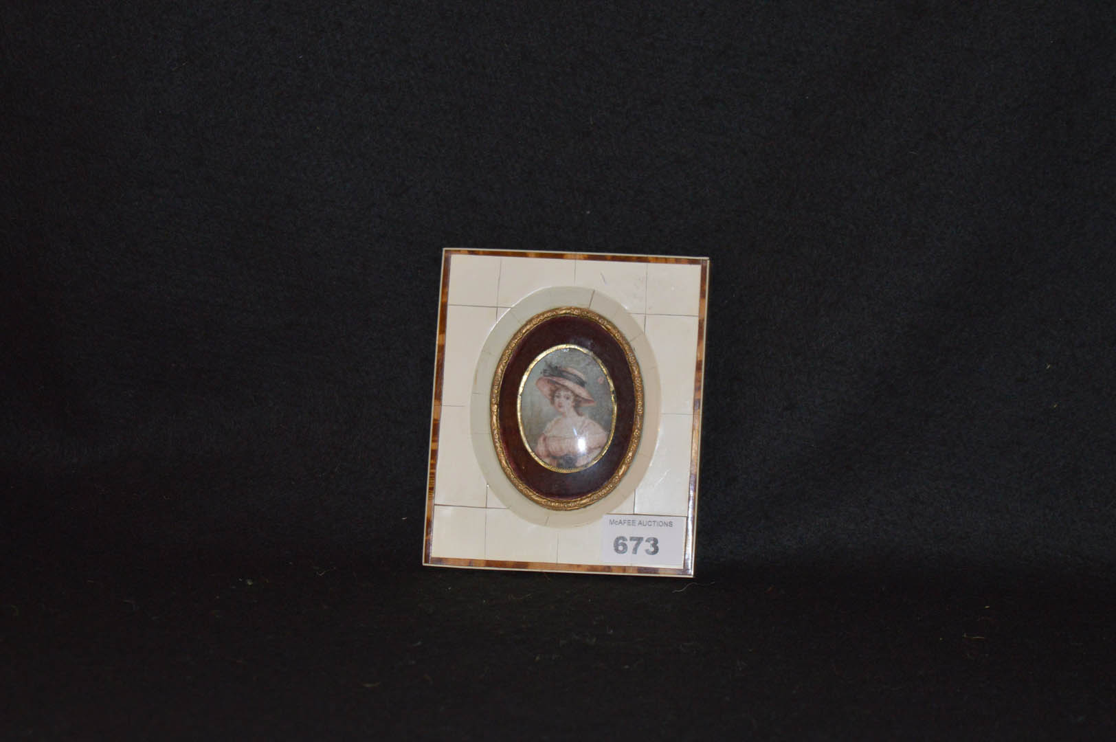Lot 673 - A Framed Minature of a Young Lady'