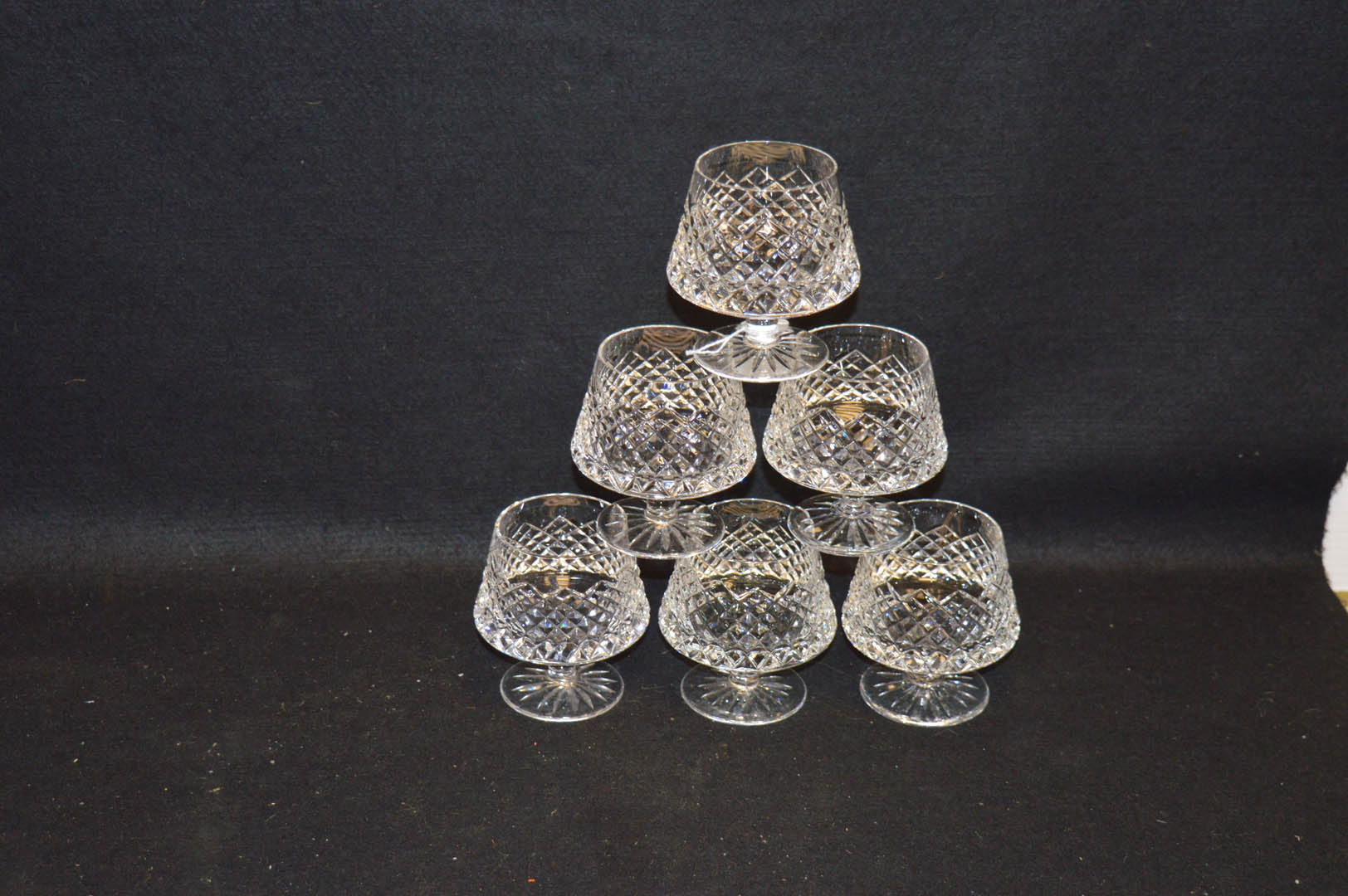 Lot 22 - A Set of Six Cut Glass Drinking Glasses
