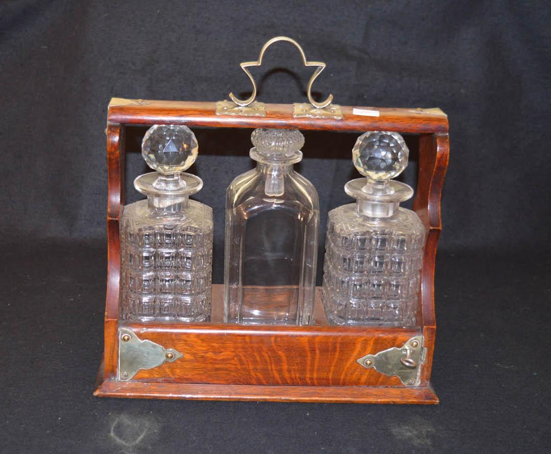 Lot 343 - A Three Bottled Oak Cased Tantalus