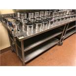 "DESCRIPTION: 60"" X 30"" ALL STAINLESS TABLE ON CASTERS. ADDITIONAL INFORMATION: W/ 4"" BACK SPLASH SHU"