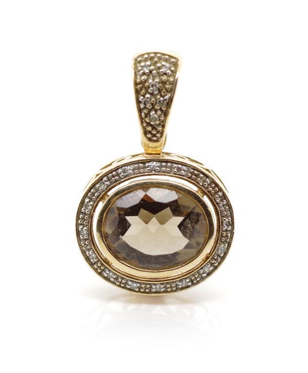 Lot 54 - Smoky quartz and diamond set yellow gold enhancer