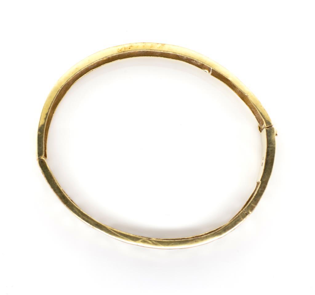 Lot 9 - 14ct yellow gold greek key bangle