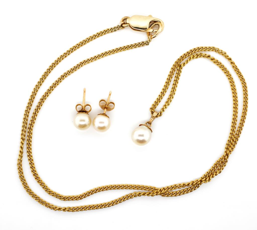 Lot 23 - Pearl set 9ct gold pendant on chain and earrings
