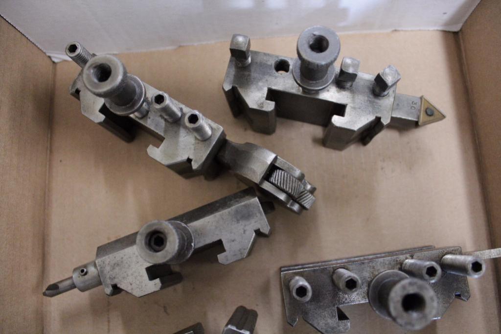 Lot 12 - Bakuer lathe tool post w/ holders