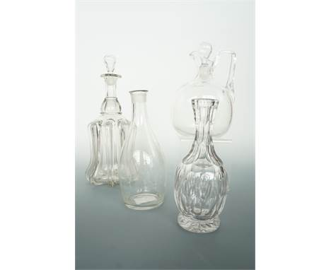 A Georgian glass decanter of Indian club form, a Victorian claret jug, ribbed-bell decanter and cut glass carafe