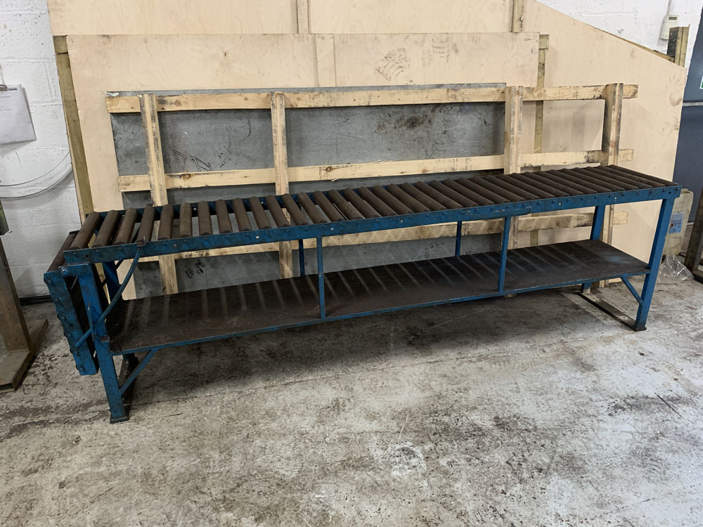 "Roller Conveyor. 18'' wide x 9' (108"") length x 31'' Height. 18'' Extension at One End."
