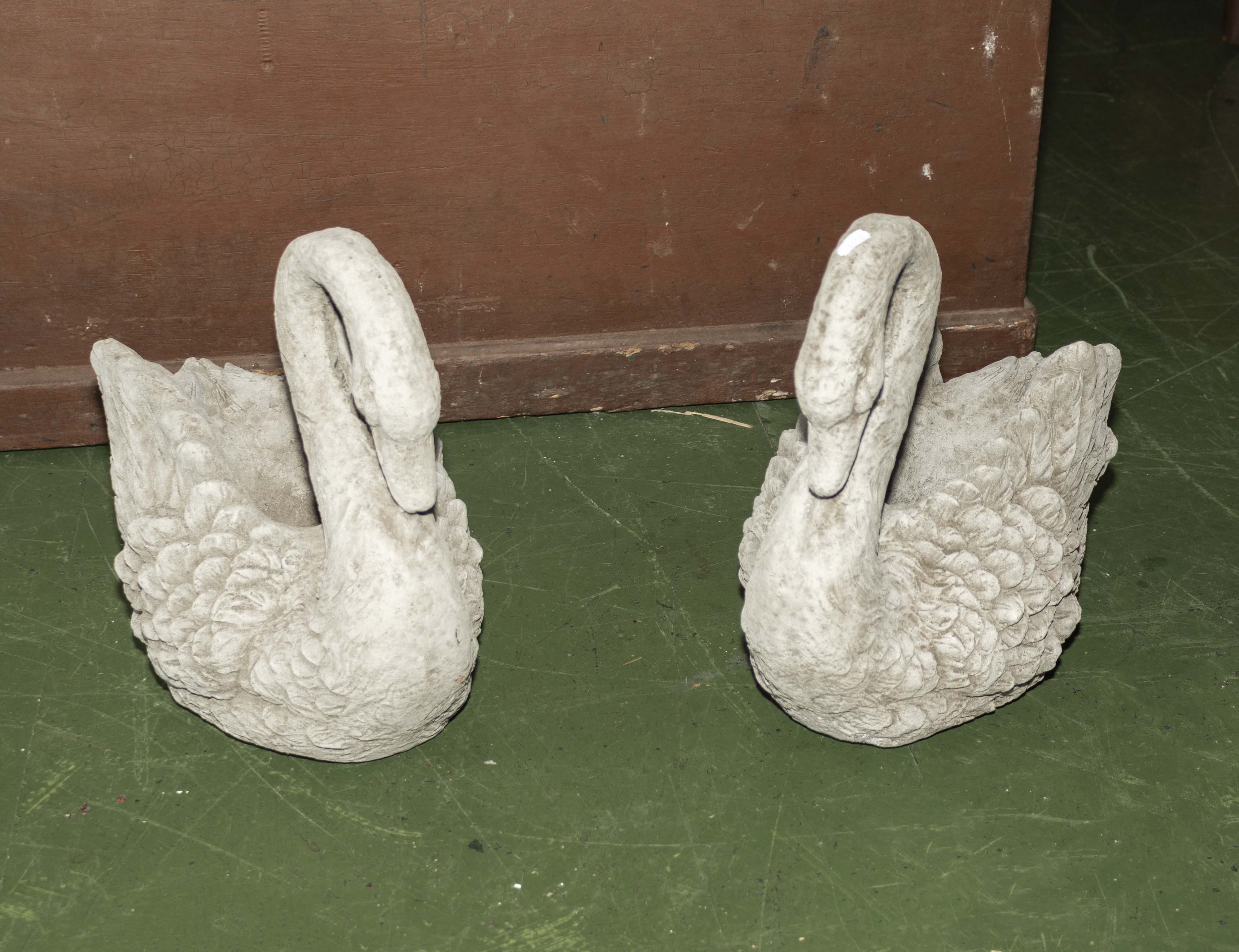 Lot 9 - A pair of reconstituted stone garden swans