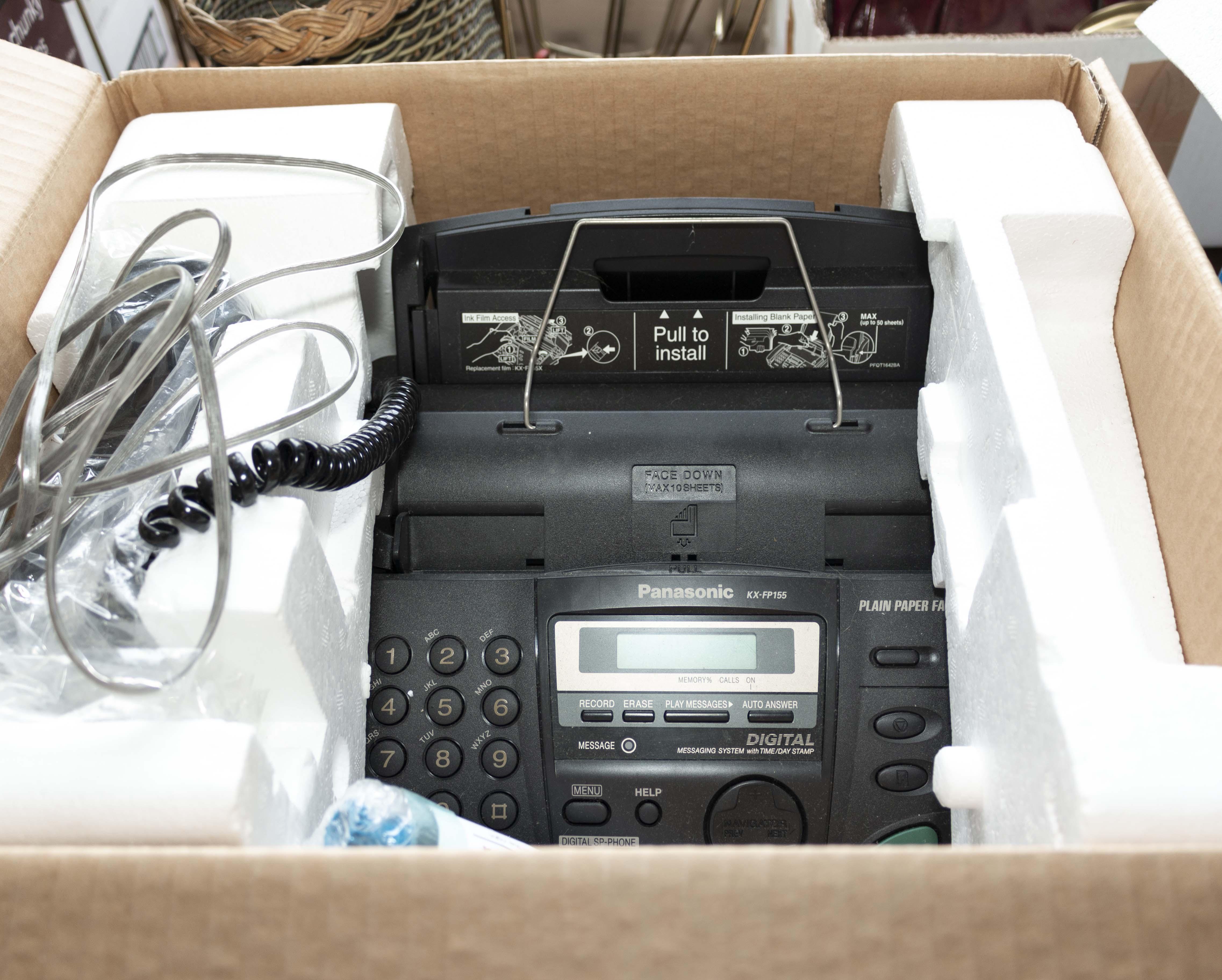 Lot 31 - A Panasonic KX-FP155E fax machine (as new)