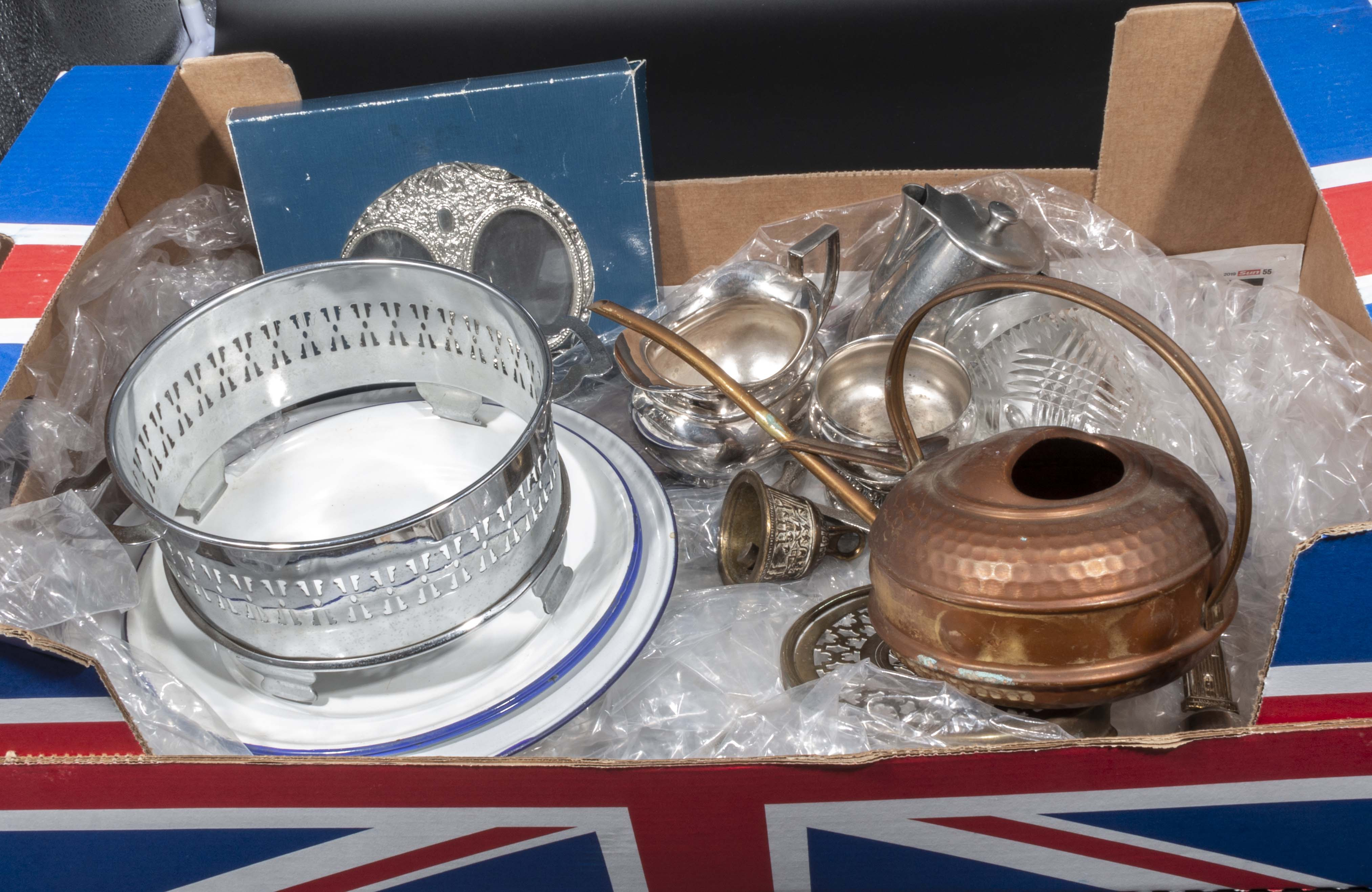 A box containing metalware