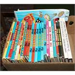 A box containing Dandy and Beano annuals