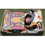A box containing vinyl records