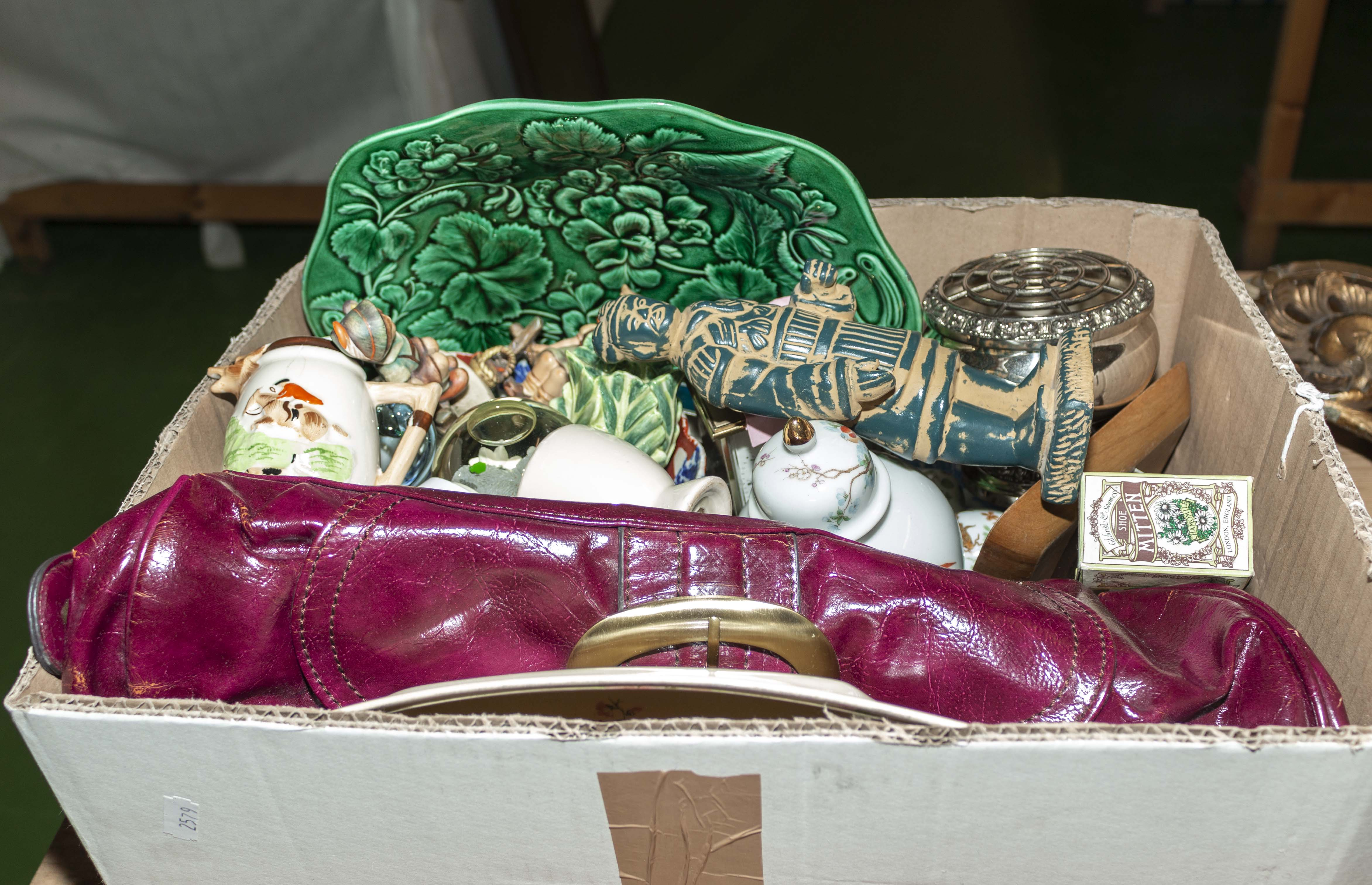Lot 25 - A box containing pottery items and others