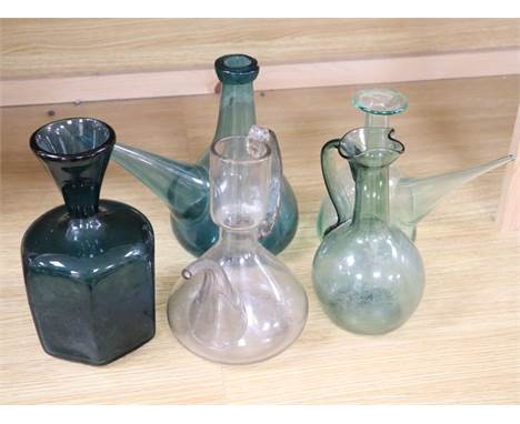 Four 19th/20th century French coloured glass porron decanters and a vine engraved carafe, 20.5 - 24cmCONDITION: Provenance -