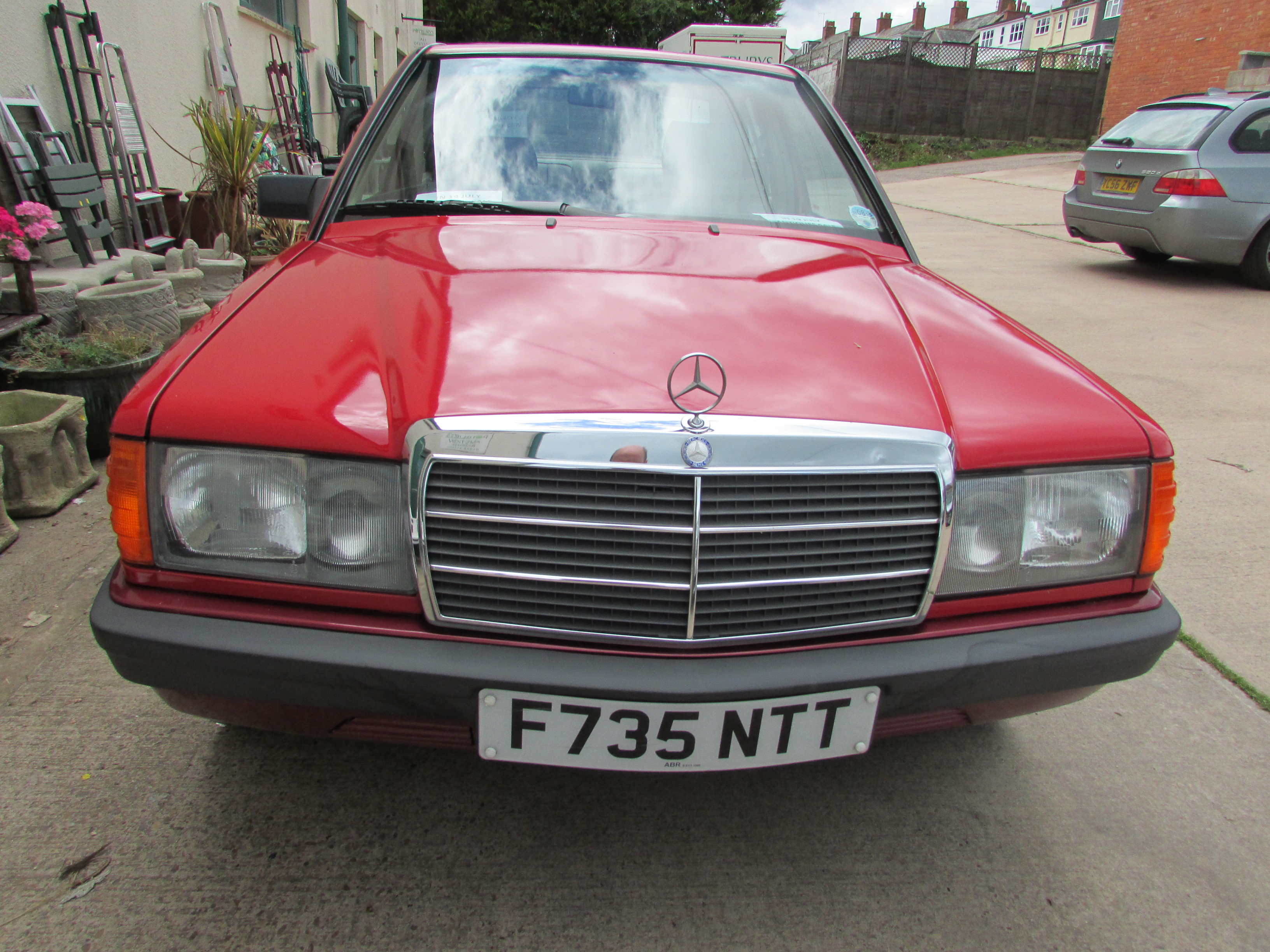 Lot 1 - Red Mercedes 190E automatic four-door saloon, 1997 cc petrol engine, F735 NTT registered 06/09/89,