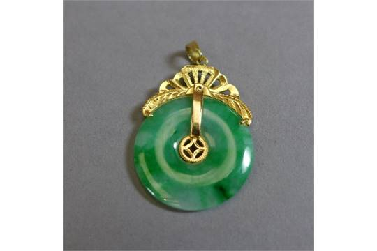 A chinese 14 carat gold and apple jade pendant the pierced jade a chinese 14 carat gold and apple jade pendant the pierced jade disc with fan form gold surmount aloadofball Image collections