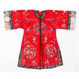 A BRIGHT RED SILK LADY'S ROBE WITH 'CHINESE LEGENDS', 1920s Silk with multi-colored silk threads,