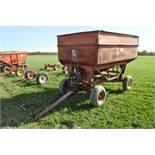 McCurdy 350 gravity wagon on gear, 14' hydr fertilizer auger, 11L-15 tires